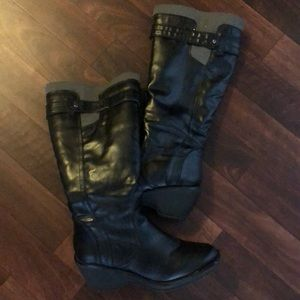 Slightly worn tall lined boots
